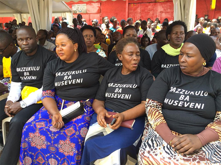 Some of the traders dressed in Bazukulu ba Museveni  T-shirts at Nakasero market