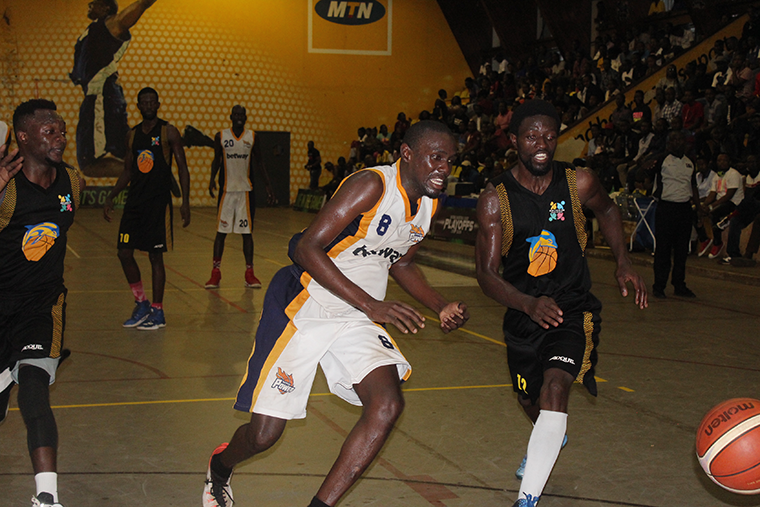 Power's Paul Odong and JKL Dolphins' Yesman Bushiri chase after a loose ball