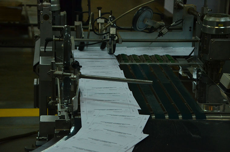 Exam papers being printed.