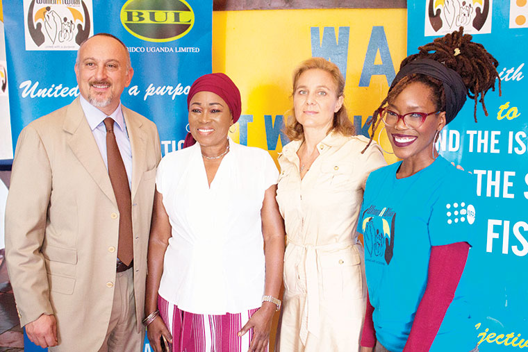 L-R Italian Ambassador Domenico Fornara, Halima Namakula, ambassador's wife Anna Muscetta and Racheal K pose for a photo after receiving their cheque