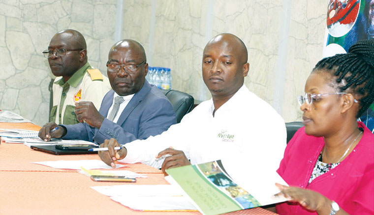 The Murchison falls protesters at a press conference led by the chairman Everest Kayondo (2nd L)