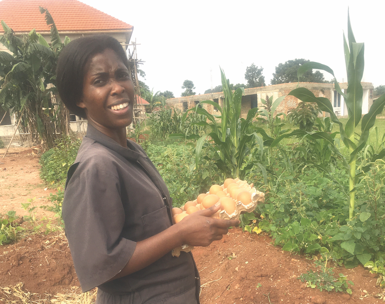 Dr Emma Naluyima with a tray of eggs from her farm
