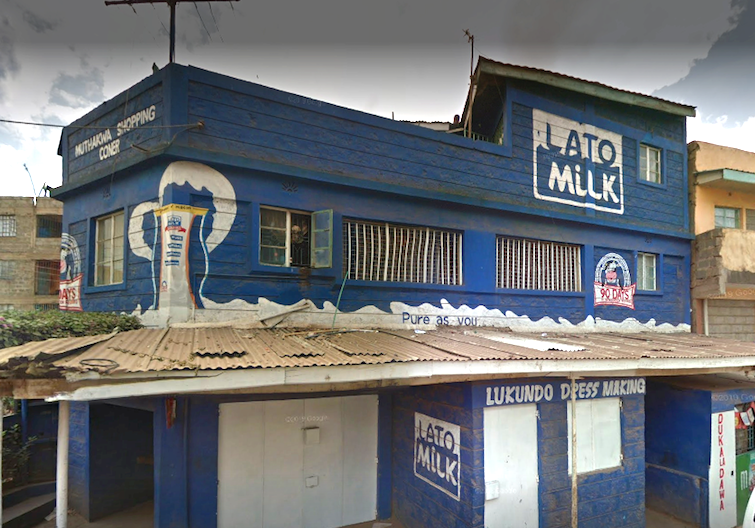 A building in Kenya branded with Lato Milk logo and colours. Photo: Google Maps