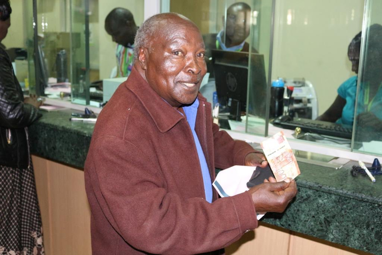 A happy Kenyan citizen with the newly issued notes