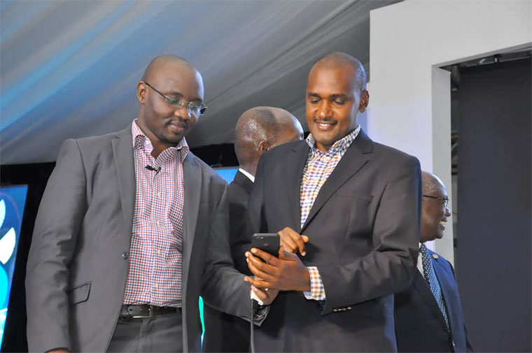 ICT minister Frank Tumwebaze tries out the new app