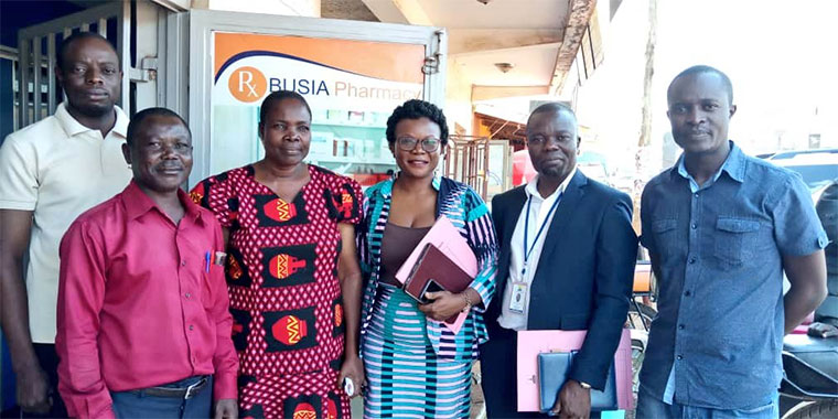 URA officials visiting Busia Pharmacy
