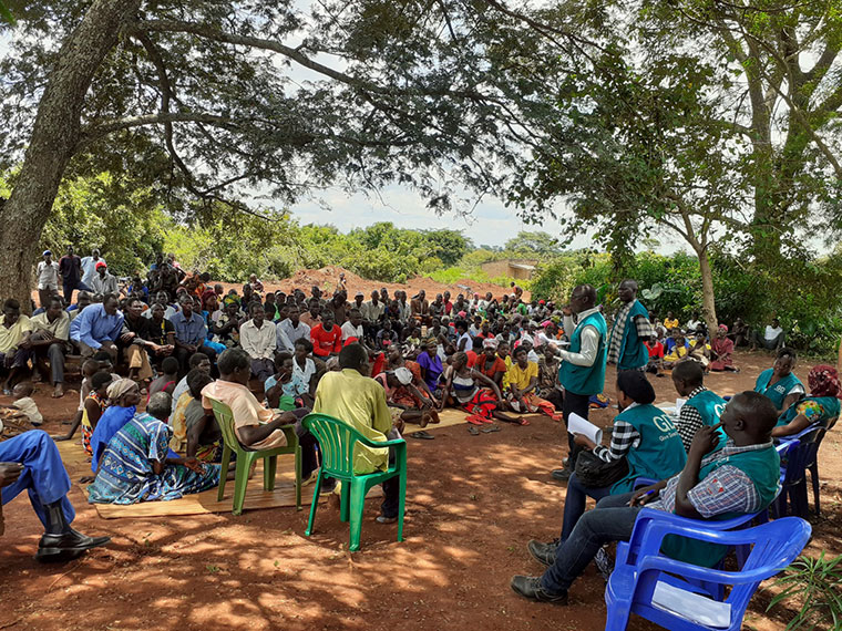 GiveDirectly officials sensitising local communities in Kiryandongo about the cash grants