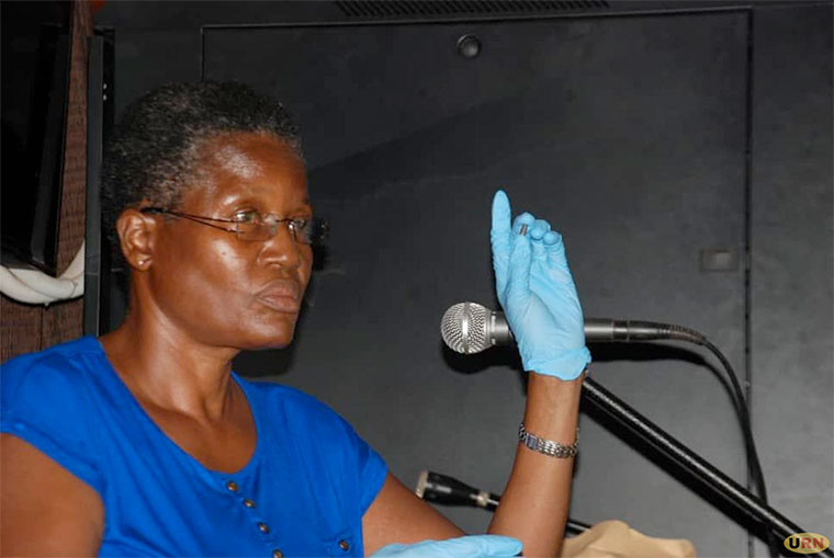 Robinah Kirinya displays in court the alleged killer bullet