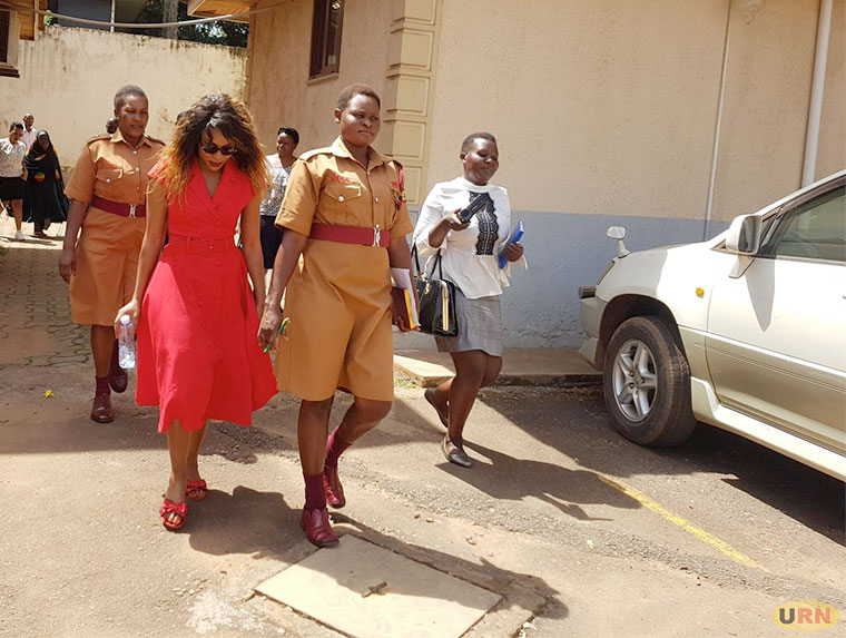 Angella Chebet (in red) at the Anti-corruption court in Kololo