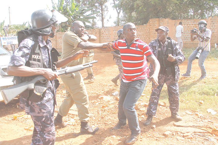 FILE PHOTO: Christopher Aine being arrested by police in 2015