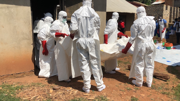Safe and dignified burial team carrying out a mock burial exercise of coronavirus victims