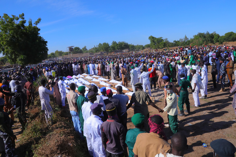 People attend a funeral for those killed by suspected Boko Haram militants in Zaabarmar, Nigeria, November 29, 2020