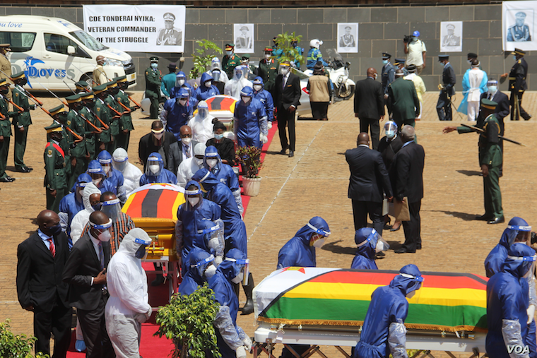 Coffins of Minister of Foreign Affairs Sibusiso Moyo, Transport Minister Joel Biggie Matiza and former head of prisons Paradzai Zimond, in Harare