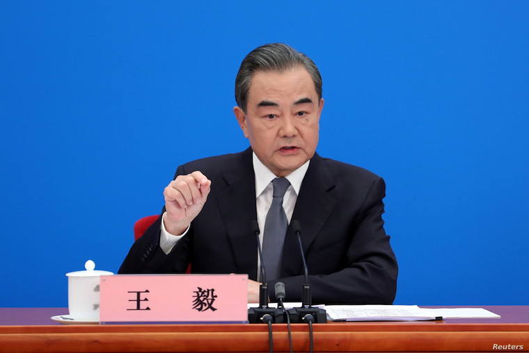 Chinese Foreign Minister Wang Yi speaks to reporters via video link at a news conference held on the sidelines of the National People's Congress (NPC), from the Great Hall of the People in Beijing, China, May 24, 2020