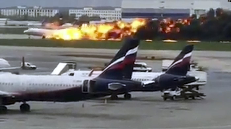 This image taken from video provided by Instagram user @artempetrovich, shows the SSJ-100 aircraft of Aeroflot Airlines on fire during an emergency landing in Sheremetyevo airport in Moscow