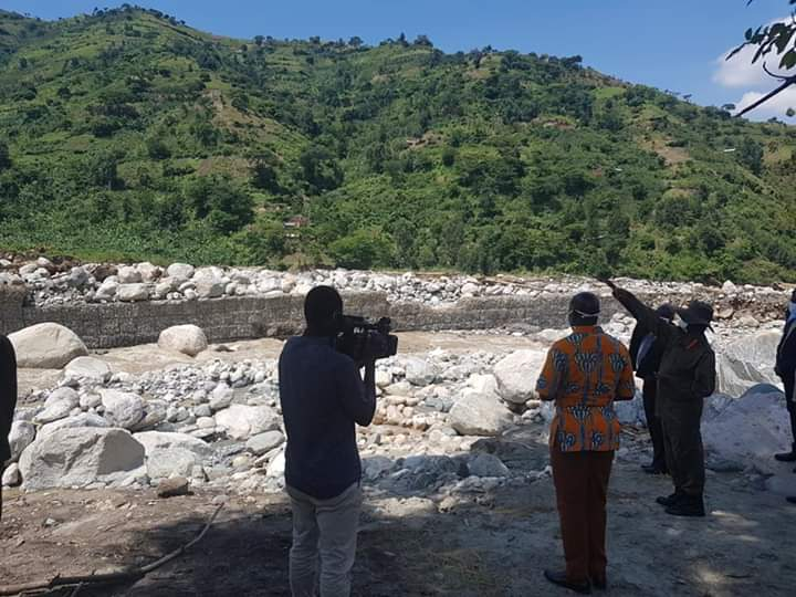 President Museveni at the spot where some structures of Kilembe Mines hospitals were washed away by floods
