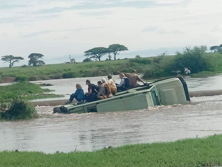 A tourist vehicle that was nearly submerged by the flash floods
