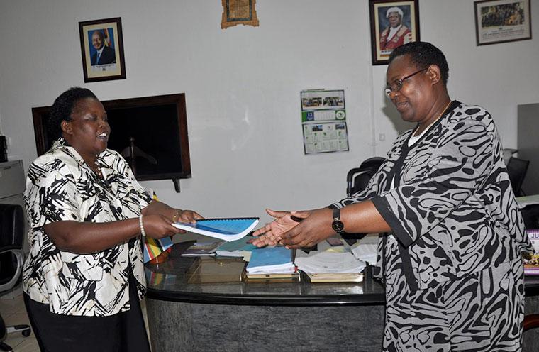 Dorcas Okalany (L) hands over office to Dr Nassali Lukwago (R) last week