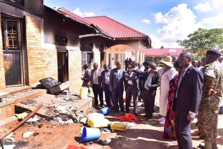 Education minister Janet Museveni and other officials assessing the extent of the damage at the school