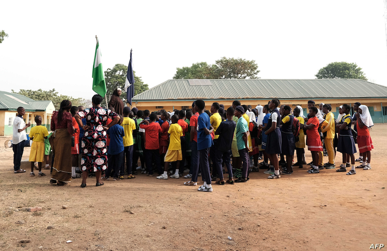 The principal of Government Secondary School, Tudun Wada, announcing the closure of schools to students at the assembly ground following an order by the Nigerian Government amid fears of the spreading of the COVID-19, in Abuja, March 20, 2020