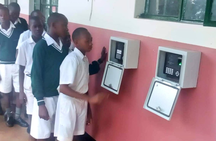 Students of Kiira college Butiki using the biometrics system roll call