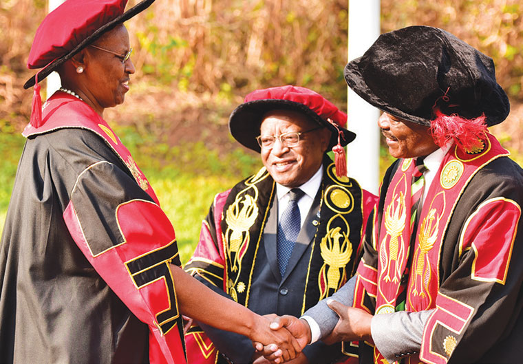 (L-R): First lady Janet Kataaha Museveni, Ezra Suruma and Prof Barnabas Nawangwe during Makerere University's first day of graduation ceremonies