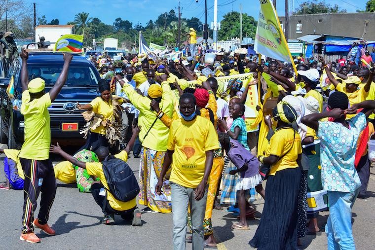 NRM supporters in Arua cheering as Museveni convoy drives through