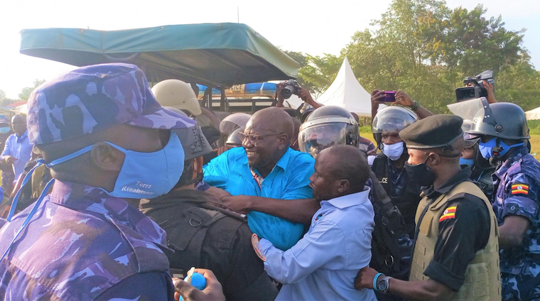 Police personnel battle with FDC supporters in Pabbo