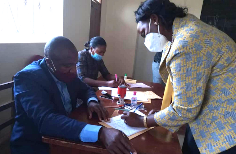 Shartsi Kuteesa signing her nomination papers