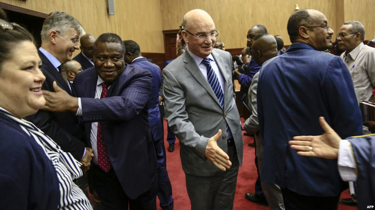 Jean-Pierre Lacroix, second left, U.N. undersecretary-general for peacekeeping, and Smail Chergui, center, AU commissioner for peace and security, greet delegates after initial peace talks between Central African Republic and armed groups in Khartoum, Sudan, Jan. 24, 2019