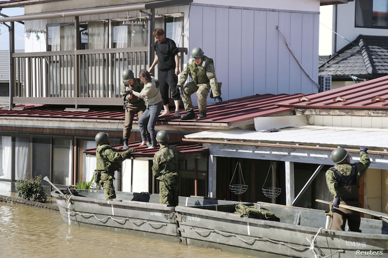 Local residents are rescued by Japanese Defense Force soldiers from a flooded area caused by Typhoon Hagibis in Kakuda, Miyagi prefecture, Japan, Oct. 13, 2019, in this photo taken by Kyodo