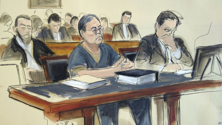 In this March 25, 2019 courtroom sketch, former Hong Kong home affairs secretary Dr. Chi Ping Patrick Ho, center, is sentenced to three years in prison after he was convicted of paying bribes to presidents of two African countries in a United Nations-linked case., in New York