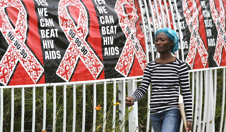 FILE A woman walks past an HIV banner in South Africa