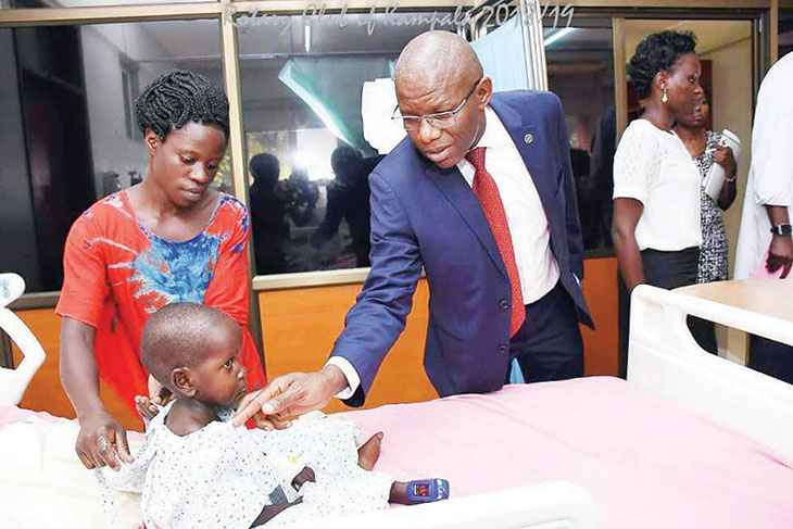 Xavier Ssentamu, the Rotary district governor-elect, checks on a child who has undergone surgery at the Uganda Heart Institute. Rotary has provided over Shs 1 billion for surgeries on 110 children