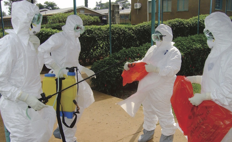 Doctors disinfect before handling Ebola patients