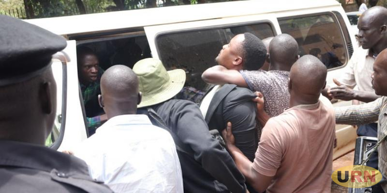 The suspects' lawyer James Mubiru being arrested
