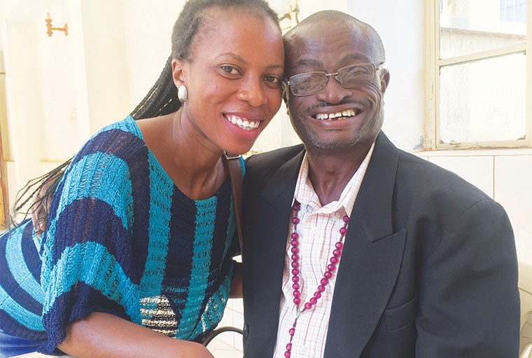 Aloysius Matovu Joy, an actor and talented singer who has been living with HIV for 33 years. His daughter Madelena Ndibalekera hugs him