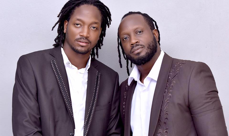 Allan Hendrick Ssali with his father Bebe Cool