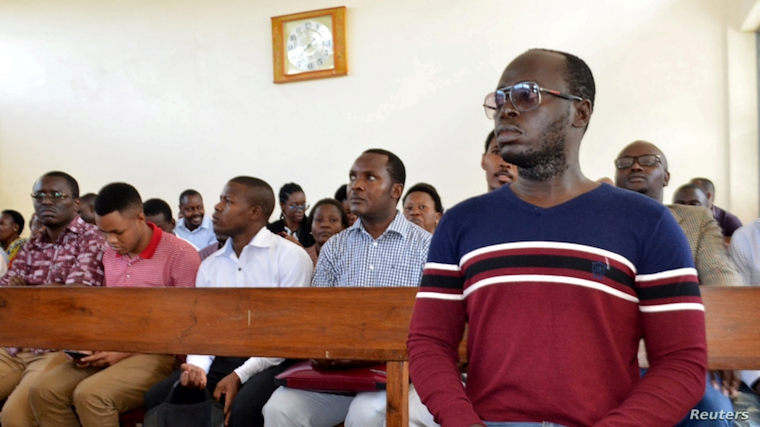 Tanzanian investigative journalist Erick Kabendera sits inside the Kisutu Residents Magistrate Court in Dar es Salaam