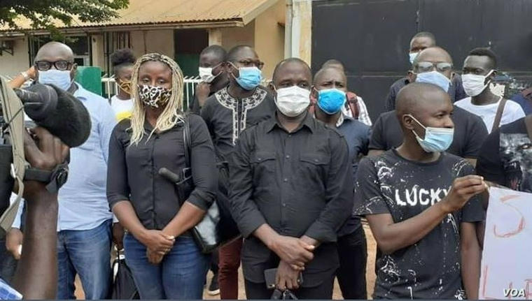 Members of the Union of Journalists and Technicians of the Guinea-Bissau Media, wearing COVID masks, hold a vigil outside Radio Capital FM in Bissau, Guinea-Bissau, Aug. 6, 2020
