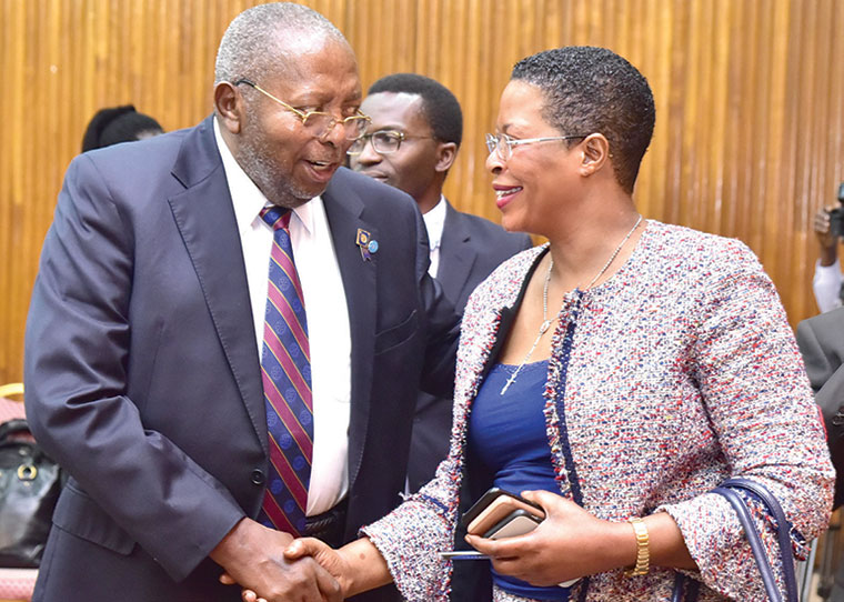 BOU governor Tumusiime-Mutebile chats with vice chairperson of COSASE committee Anita Among