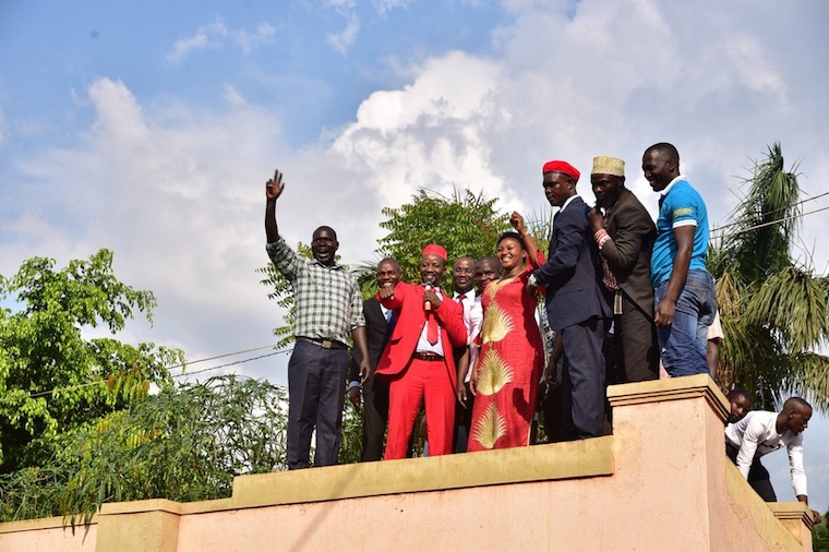 Ssemujju addressing residents from his fence