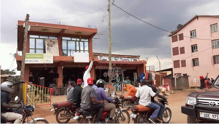 Bobi Wine riding on a boda boda in downtown Kampala. Photo: NBS TV