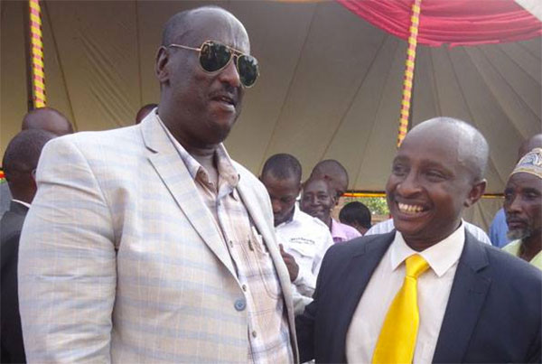 Moses Karangwa (R) with President Museveni's brother Gen Salim Saleh
