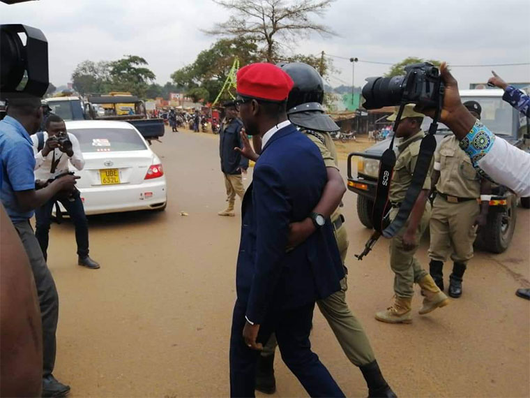 Bobi Wine being led away by police. Photo: NTVUganda