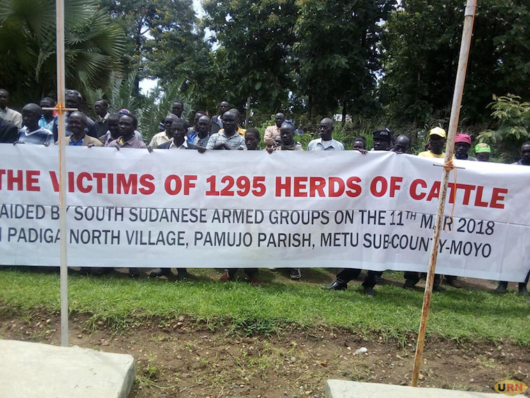 Victims of the raid demonstrating with a banner infront of Moyo RDCs office on Saturday