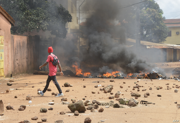 FILE Protesters burn barricades and tires in a Conakry street during a demonstration in Guinea