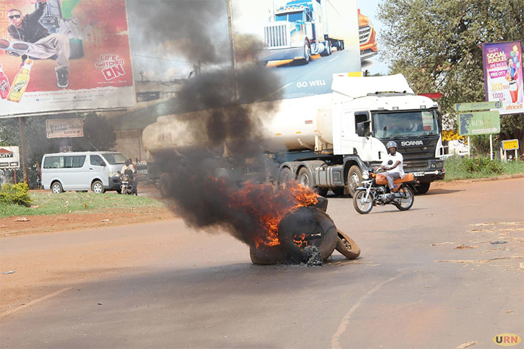 Tyres set ablaze by protestors near Umbercoat round blocked vehicles from accessing the new Jinja bridge