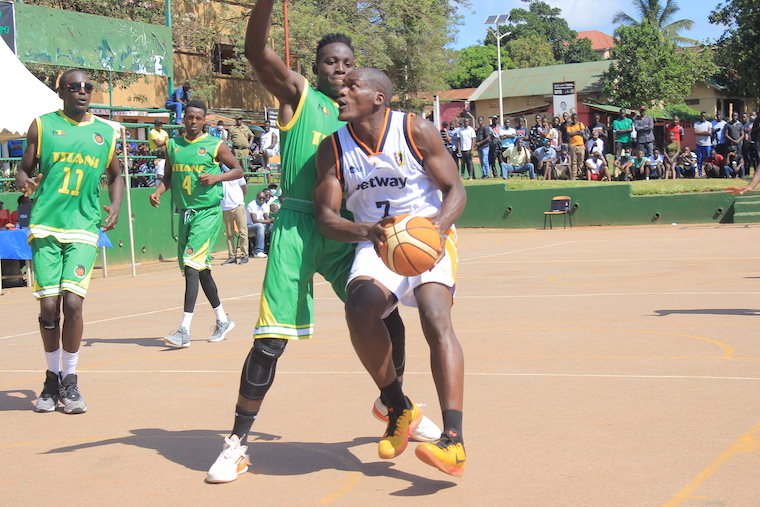 Betway Power's Isaac Afidra attempts to go past KIU Titans' Stanley Mugerwa