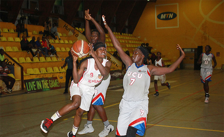 Jamilah Nansikombi goes for the hoop, as UCU's Angella Lokwamweri tries to stop her